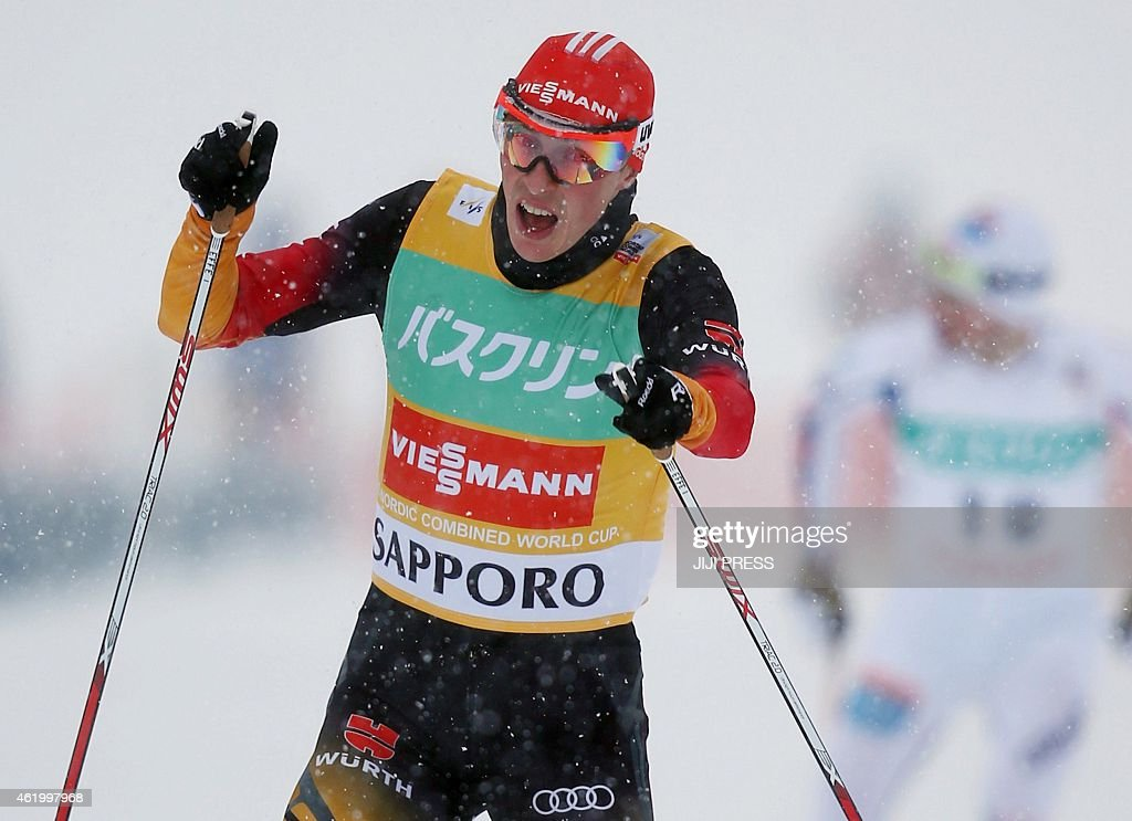 Germany's <a gi-track='captionPersonalityLinkClicked' href=/galleries/search?phrase=Eric+Frenzel&family=editorial&specificpeople=4595984 ng-click='$event.stopPropagation()'>Eric Frenzel</a> crosses the finish line of the FIS Nordic Combined World Cup in Sapporo in Japan's northern island of Hokkaido on January 23, 2015. Frencel won the Individual Gundersen 10 km event. AFP PHOTO / JIJI PRESS JAPAN OUT