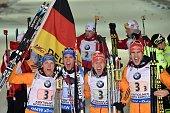 Germany's Erik Lesser Simon Schempp Daniel Boehm and Arnd Peiffer react after the Men 4x75 relay at the IBU Biathlon World Championship in...