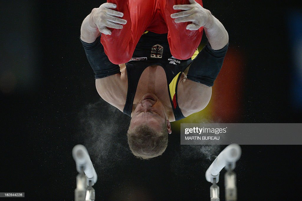 Germany's Fabian Hambuechen performs during the parallel bars qualification at the World Artistic Gymnastics Championships on September 30 2013 in...