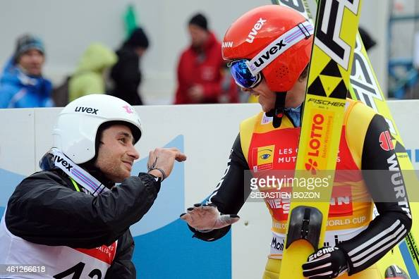 Germany's Fabian Riessle jokes with France's Jason Lamy Chappuis during the individual Gundersen of the FIS Nordic Combined World Cup on January 10...