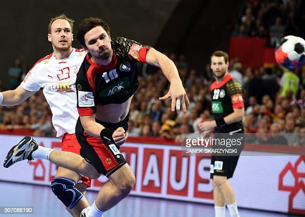 Germany's Fabian Wiede vies with Denmark's Henrik Toft Hansen during their match of the Men's 2016 EHF European Handball Championship between Germany...