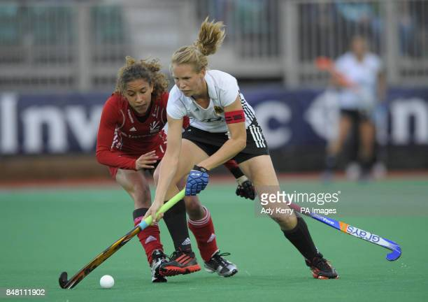 Germany's Fanny Rinne is challenged by Great Britain's Kerry Williams during their pool game in the Investec London Cup at the Quintin Hogg Memorial...
