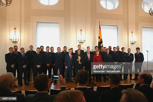 Germanys Federal President Joachim Gauck German Chancellor Angela Merkel and German Minister of the Interior Thomas de Maiziere pose with the German...