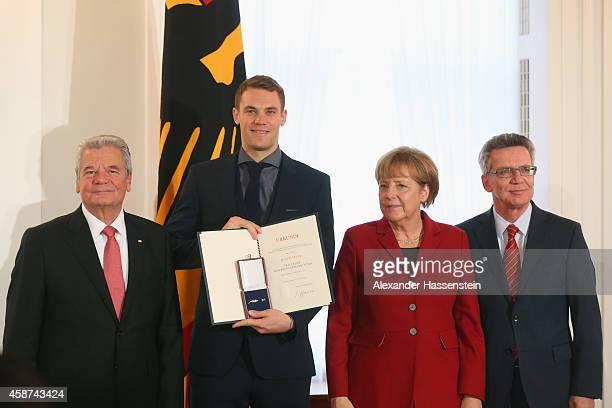 Germanys Federal President Joachim Gauck German Chancellor Angela Merkel and and German Minister of the Interior Thomas de Maiziere awards Manuel...
