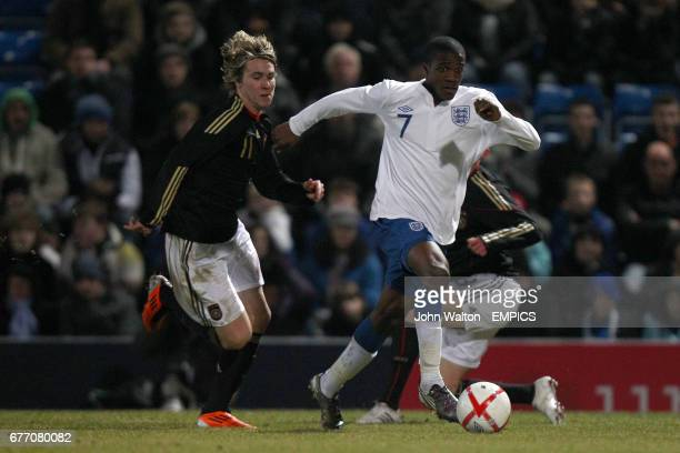 Germany's Felix Klaus and England's Wilfried Zaha in action