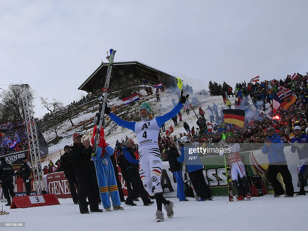 Germany's Felix Neureuther (C) celebrates after competing at the second run of the FIS World Cup men's slalom race on January 27, 2013 in Kitzbuehel, Austrian Alps. Austrian Marcel Hirscher won the race, German Felix Neureuther placed second and Croatian Ivica Kostelic placed third.