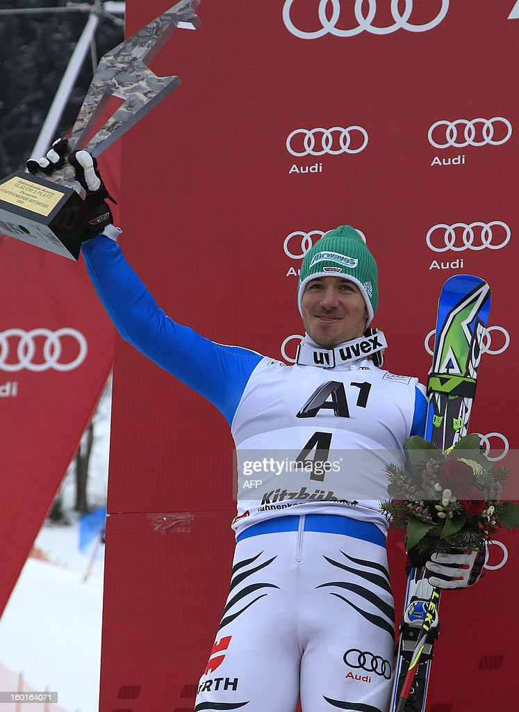 Germany's Felix Neureuther celebrates on the podium after placing second at the FIS World Cup men's slalom race on January 27, 2013 in Kitzbuehel, Austrian Alps. Marcel Hirscher placed first, German Felix Neureuther placed second and Croatian Ivica Kostelic placed third.