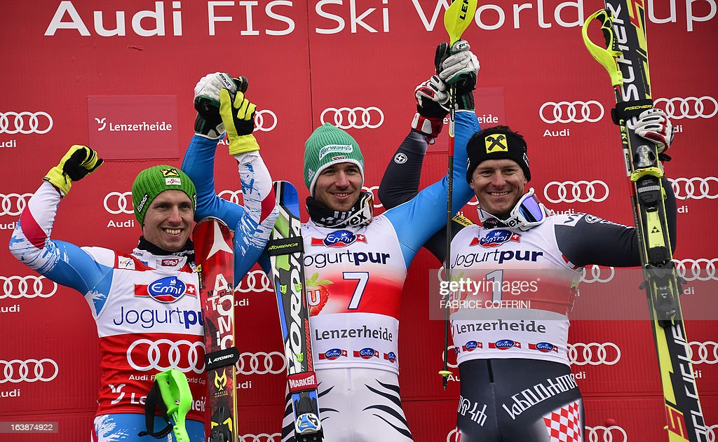 Germany's Felix Neureuther (C) celebrates on the podium after winning the men's Slalom race, with Austria's Marcel Hirscher (L, 2nd) and Croatia's Ivica Kostelic (R, 3rd) at the Alpine ski World Cup finals on March 17, 2013 in Lenzerheide.