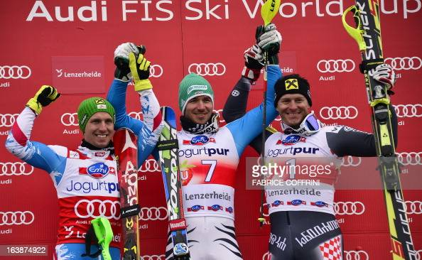 Germany's Felix Neureuther celebrates on the podium after winning the men's Slalom race with Austria's Marcel Hirscher and Croatia's Ivica Kostelic...