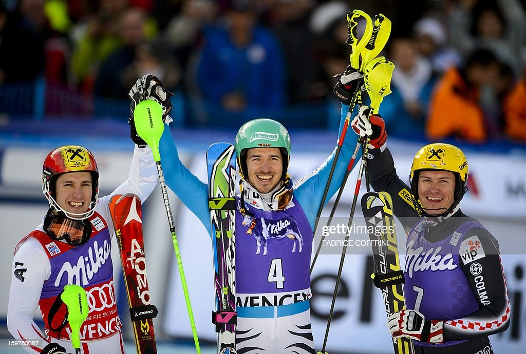 Germany's Felix Neureuther (C) poses on January 20, 2013 after winning the men's slalom of the FIS Alpine Skiing World Cup with second-placed Austrian Marcel Hirscher (L) and third-placed Croatian Ivica Kostelic (R) in Wengen.