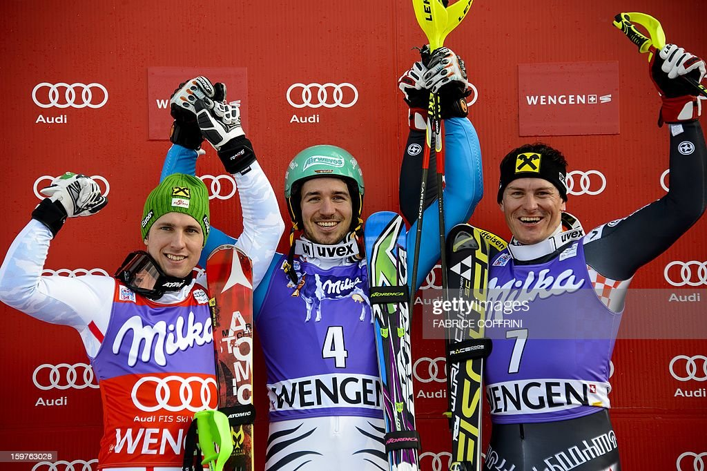 Germany's Felix Neureuther (C) poses on the podium on January 20, 2013 after winning the men's slalom of the FIS Alpine Skiing World Cup with second-placed Austrian Marcel Hirscher (L) and third-placed Croatian Ivica Kostelic (R) in Wengen. AFP PHOTO / FABRICE COFFRINI