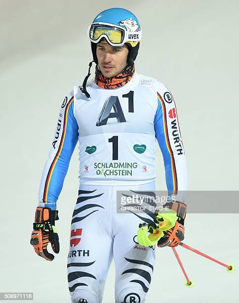 Germany's Felix Neureuther reacts after dropping out of the final race of the FIS Alpine Ski World Cup Men's nightrace slalom competition in...