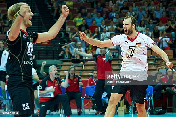 Germany's Ferdinand Tille celebrates winning the point with Germany's Dirk Westphal during the FIVB World Championships match between Germany and...