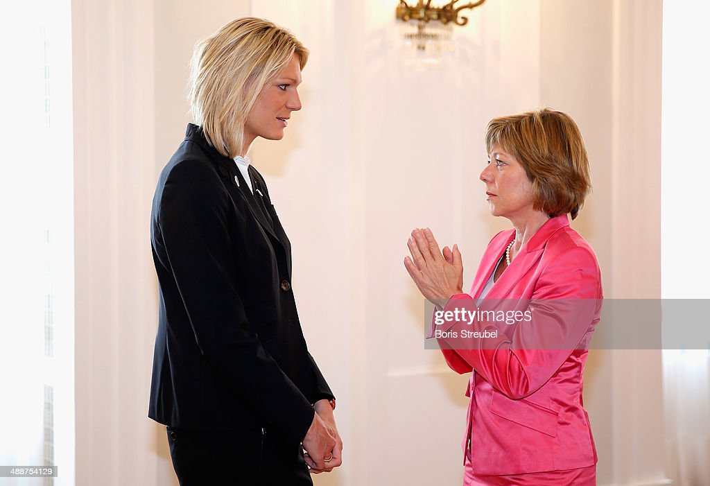 Germany's first lady <a gi-track='captionPersonalityLinkClicked' href=/galleries/search?phrase=Daniela+Schadt&family=editorial&specificpeople=7055235 ng-click='$event.stopPropagation()'>Daniela Schadt</a> (R) talks to <a gi-track='captionPersonalityLinkClicked' href=/galleries/search?phrase=Maria+Hoefl-Riesch&family=editorial&specificpeople=7648886 ng-click='$event.stopPropagation()'>Maria Hoefl-Riesch</a>, Germany's gold medalist for the women's Alpine Skiing Super Combined and silver medalist of the women's Alpine Skiing Super-G during the Silbernes Lorbeerblatt Award Ceremony at Schloss Bellevue on May 8, 2014 in Berlin, Germany.