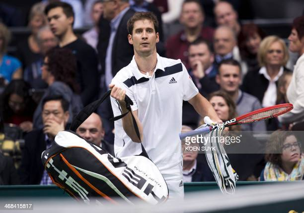 Germany's Florian Mayer reacts after losing his first round match against France's JoWilfried Tsonga during the ABN AMRO World Tennis Tournament in...