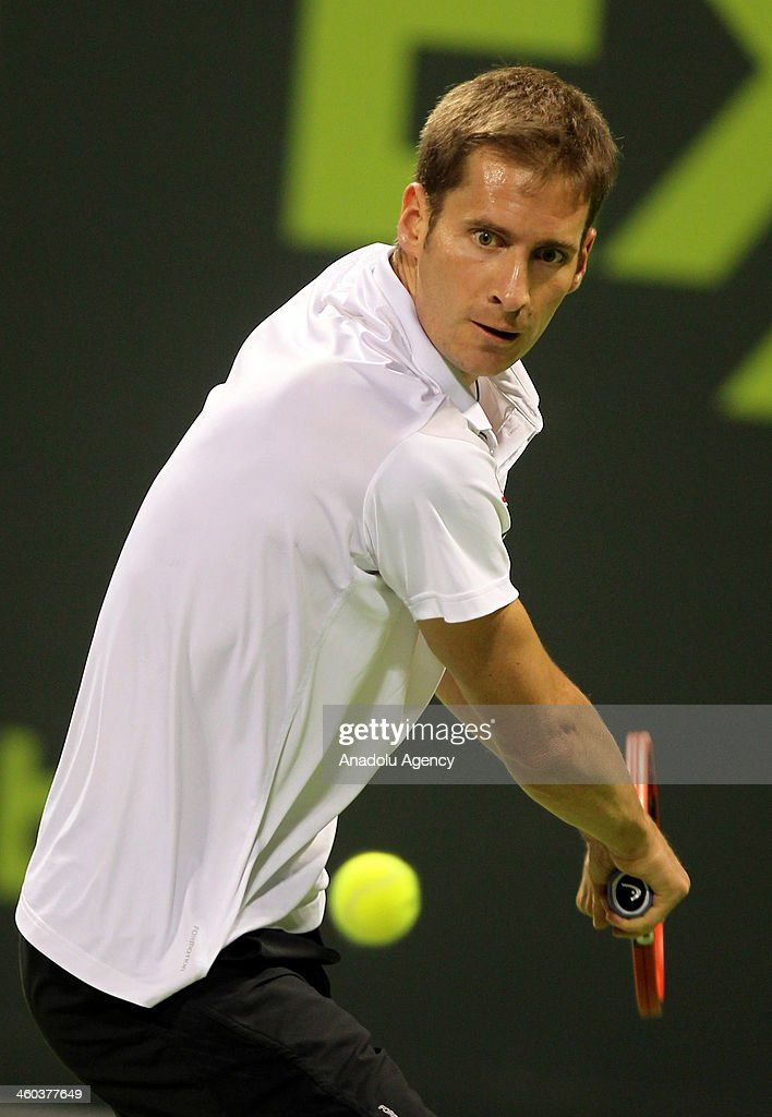 Germany's Florian Mayer returns the ball to Gael Monfils of France during their semifinal tennis match in Qatar ExxonMobil Open tennis tournament at...
