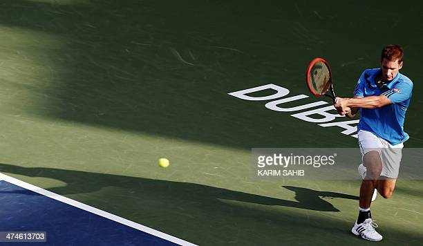 Germany's Florian Mayer returns the ball to Italy's Andreas Seppi during their day one match in the Dubai Duty Free Tennis Championships on February...