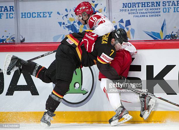 Germany's Florian Ondruschka fights for the puck with Denmark's Kirill Starkov during a preliminary round match at the Ice Hockey World Championships...