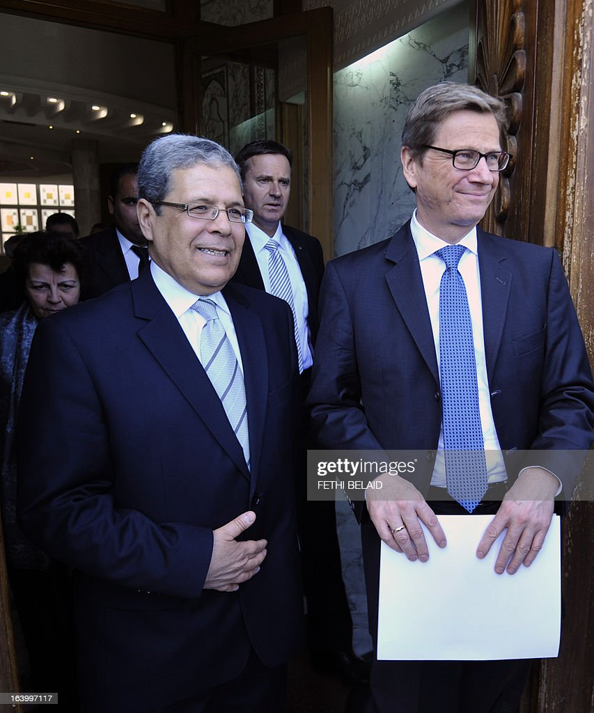 Germany's Foreign Affairs Minister Guido Westerwelle (R) stands with Tunisian counterpart Othmane Jarandi on March 19, 2013, in Tunis. Westerwelle is on a day official visit to Tunisia.