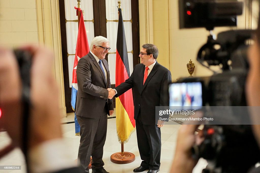 Germanys Foreign Minister Frank Walter Steinmeier (L) and Bruno Rodriguez (R), Cubas Foreign Minister, shake hands prior to conversations on what is the first visit ever of a West German Foreign Minister to Cuba, on July 16, 2015, in Havana, Cuba. On the first day of his two day visit Steinmeier witnessed the signing of a bilateral treaty between the two countries to work more closely together in politics, commerce and culture. Steinmeier said the long period of silence between Cuba and Germany had finally come to an end. The visit takes place just four days before Cuba will open its embassy in Washington and soon before the planned opening of the US embassy in Havana.