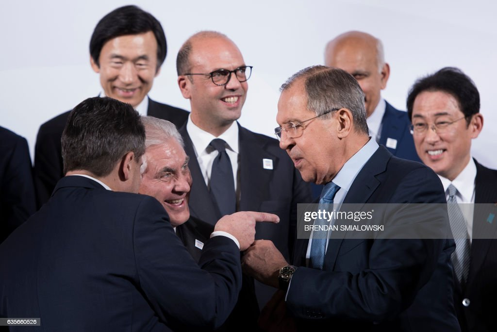 Germany's Foreign Minister Sigmar Gabriel (L), US Secretary of State Rex Tillerson (C) and Russia's Foreign Minister Sergey Lavrov talk after a group photo of G-20 foreign ministers during a meeting at the World Conference Center February 16, 2017 in Bonn, Germany. US Secretary of State Rex Tillerson makes his diplomatic debut at a G20 gathering in Germany on February 16, 2017 where his counterparts hope to find out what 'America First' means for the rest of the world. / AFP / Brendan Smialowski