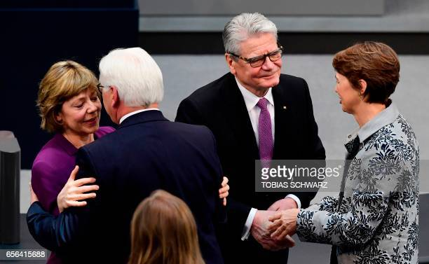 Germany's former President Joachim Gauck is greeted after his speech by Elke Buedenbender the wife of the new President as the new President...