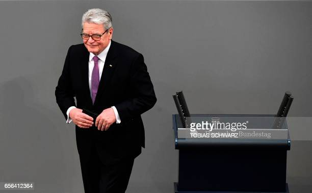 Germany's former President Joachim Gauck leaves the podium after addressing a speech during the swearingin ceremony for the new German President at...
