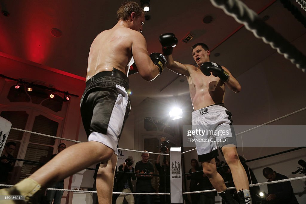 Germany's former world champion Frank Stoldt (R) competes against Belarus' light-heavyweight world champion Leonid Chernobaev (YY) during France's first official chessboxing match on February 1, 2013 at Artcurial auction house in Paris. Chess boxing is a hybrid sport that combines chess with boxing in alternating rounds. The sport was invented by French artist and filmmaker Enki Bilal in one of his comic book in 1992. AFP PHOTO FRANCOIS GUILLOT