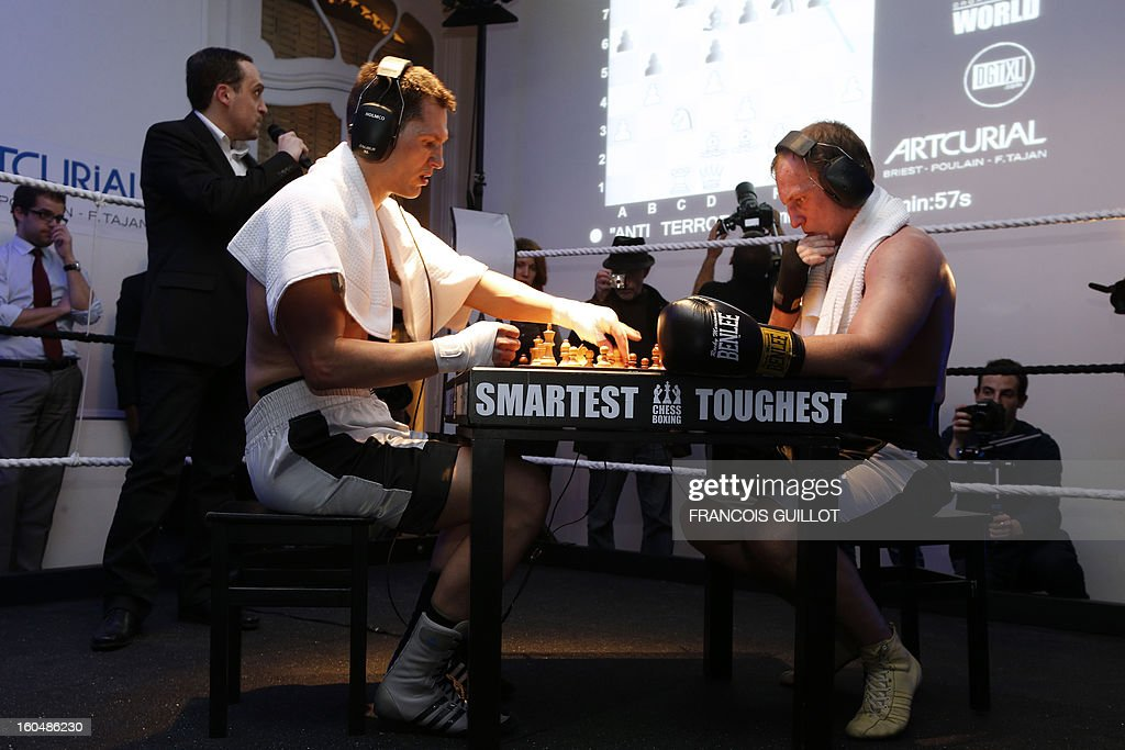 Germany's former world champion Frank Stoldt (L) competes against Belarus' light-heavyweight world champion Leonid Chernobaev (YY) during France's first official chessboxing match on February 1, 2013 at Artcurial auction house in Paris. Chess boxing is a hybrid sport that combines chess with boxing in alternating rounds. The sport was invented by French artist and filmmaker Enki Bilal in one of his comic book in 1992.
