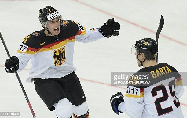 Germany's forward Alexander Barta and defender Benedikt Kohl celebrate their goal during the match Belarus vs Germany as part of the preliminary...