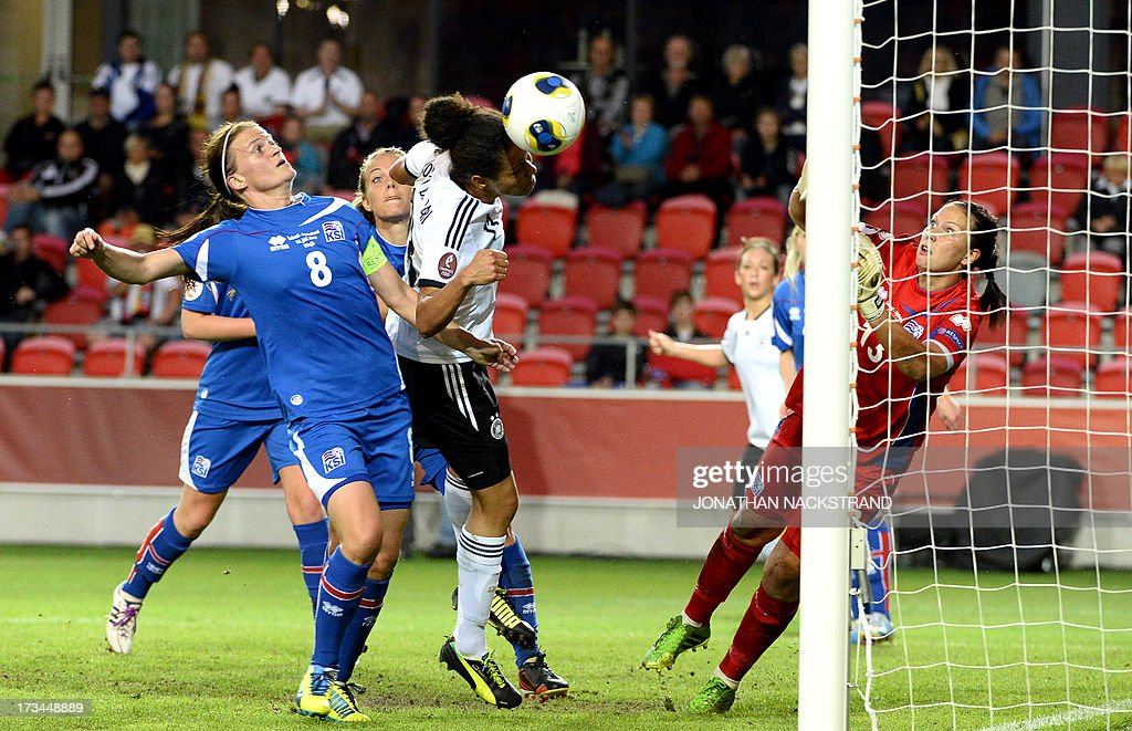 Germany's forward Celia Okoyino da Mbabi (C) tries to score past Iceland's goalkeeper Gudborg Gunnarsdottir during the UEFA Women's European Championship Euro 2013 group B football match Iceland vs Germany on July 14, 2013 in Vaxjo, Sweden.