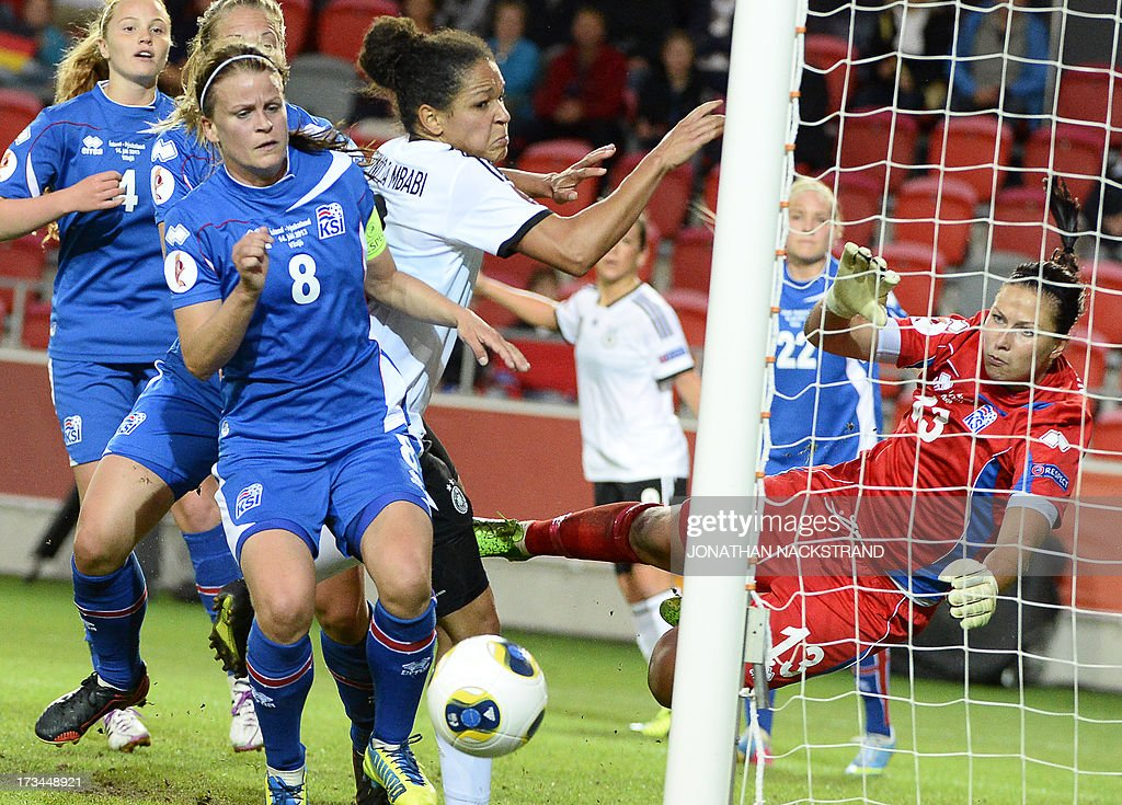 Germany's forward Celia Okoyino da Mbabi (C) tries to score past Iceland's goalkeeper Gudbjorg Gunnarsdottir during the UEFA Women's European Championship Euro 2013 group B football match Iceland vs Germany on July 14, 2013 in Vaxjo, Sweden.AFP PHOTO/JONATHAN NACKSTRAND
