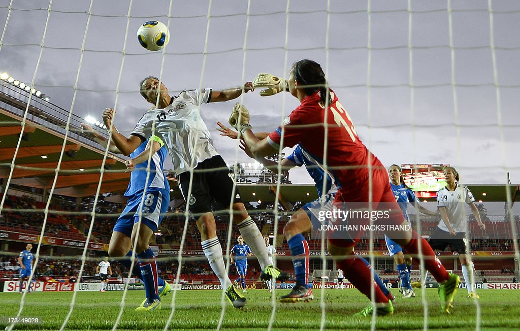 Germany's forward Celia Okoyino da Mbabi (L) tries to score past Iceland's goalkeeper Gudbjorg Gunnarsdottir during the UEFA Women's European Championship Euro 2013 group B football match Iceland vs Germany on July 14, 2013 in Vaxjo, Sweden.