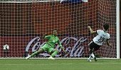 Germany's forward Celia Sasic scores a goal during the quarterfinal football match between Germany and France in the 2015 FIFA Women's World Cup at...