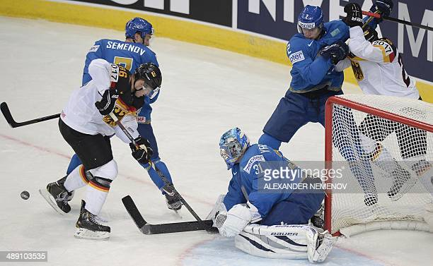 Germany's forward Daniel Pietta attacks Kazakhstan's goalie Vitali Yeremeyev during a preliminary round group B game Kazakhstan vs Germany of the...