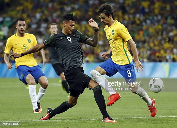 Germany's forward Davie Selke and Brazil's defender Rodrigo Caio vie for the ball during the Rio 2016 Olympic Games men's football gold medal match...