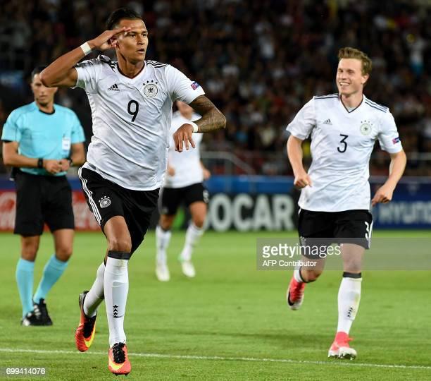 Germany's forward Davie Selke celebrates scoring with his teammate Germany's defender Yannick Gerhardt during the UEFA U21 European Championship...