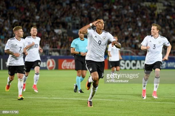 Germany's forward Davie Selke celebrates scoring with his teammates during the UEFA U21 European Championship Group C football match Germany v...