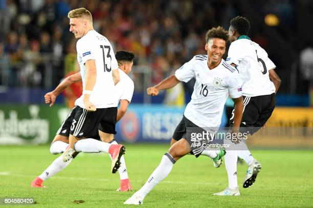 Germany's forward Felix Platte and Germany's defender Thilo Kehrer celebrate after wining 10 during the UEFA U21 European Championship football final...