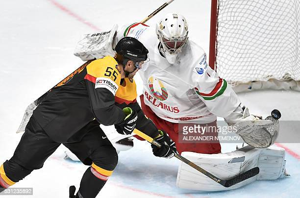Germany's forward Felix Schutz scores despite Belarus' goalkeeper Vitali Koval during the group B preliminary round game Germany vs Belarus at the...