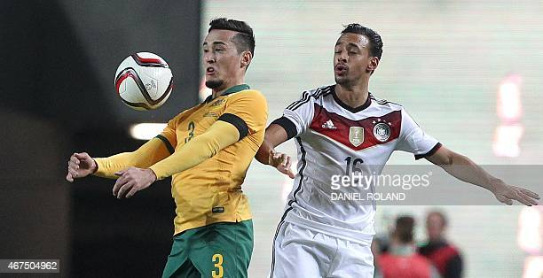 Germany's forward Karim Bellarabi and Australia's defender Jason Davidson vie for the ball during the friendly football match Germany vs Australia in...