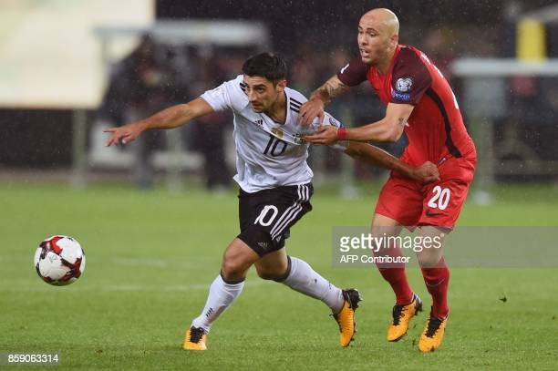 Germany's forward Lars Stindl vies with Azerbaijan's Richard Almeida during the FIFA World Cup 2018 qualification football match between Germany and...