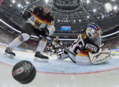 Germany's forward Leon Draisaitl and Germany's goalie Rob Zepp fail to block the puck during a IIHF International Ice Hockey World Championship...
