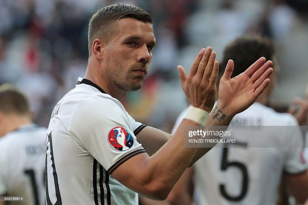 Germany's forward Lukas Podolski celebrates at the end of the Euro 2016 round of 16 football match between Germany and Slovakia at the Pierre-Mauroy stadium in Villeneuve-d'Ascq near Lille on June 26, 2016. / AFP / KENZO
