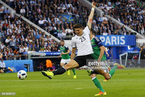 TOPSHOT Germany's forward Mario Gomez plays the ball during the Euro 2016 group C football match between Northern Ireland and Germany at the Parc des...