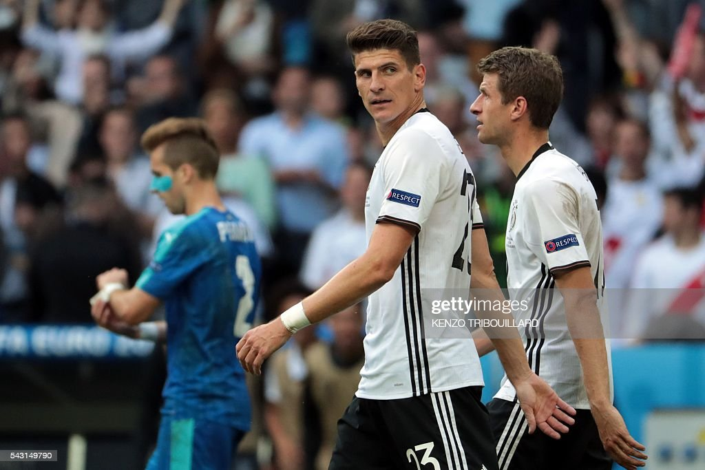 Germany's forward Mario Gomez (C) reacts after scoring a goal during the Euro 2016 round of 16 football match between Germany and Slovakia at the Pierre-Mauroy stadium in Villeneuve-d'Ascq near Lille on June 26, 2016. / AFP / KENZO