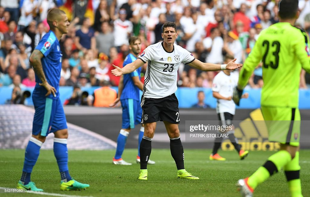 Germany's forward Mario Gomez (C) reacts during the Euro 2016 round of 16 football match between Germany and Slovakia at the Pierre-Mauroy stadium in Villeneuve-d'Ascq near Lille on June 26, 2016. / AFP / PATRIK