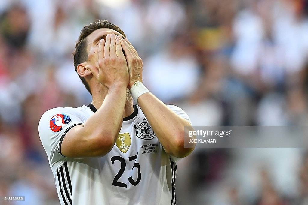 Germany's forward Mario Gomez reacts during the Euro 2016 round of 16 football match between Germany and Slovakia at the Pierre-Mauroy stadium in Villeneuve-d'Ascq near Lille on June 26, 2016. / AFP / Joe KLAMAR