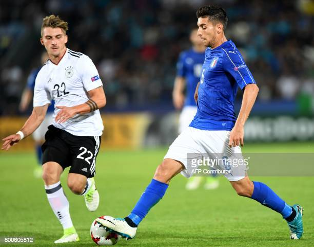Germany's forward Maximilian Philipp and Italy's midfielder Lorenzo Pellegrini vie for the ball during the UEFA U21 European Championship Group C...