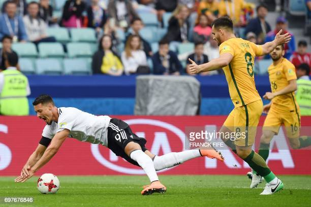 TOPSHOT Germany's forward Sandro Wagner is challemged for the ball by Australia's defender Bailey Wright during the 2017 Confederations Cup group B...